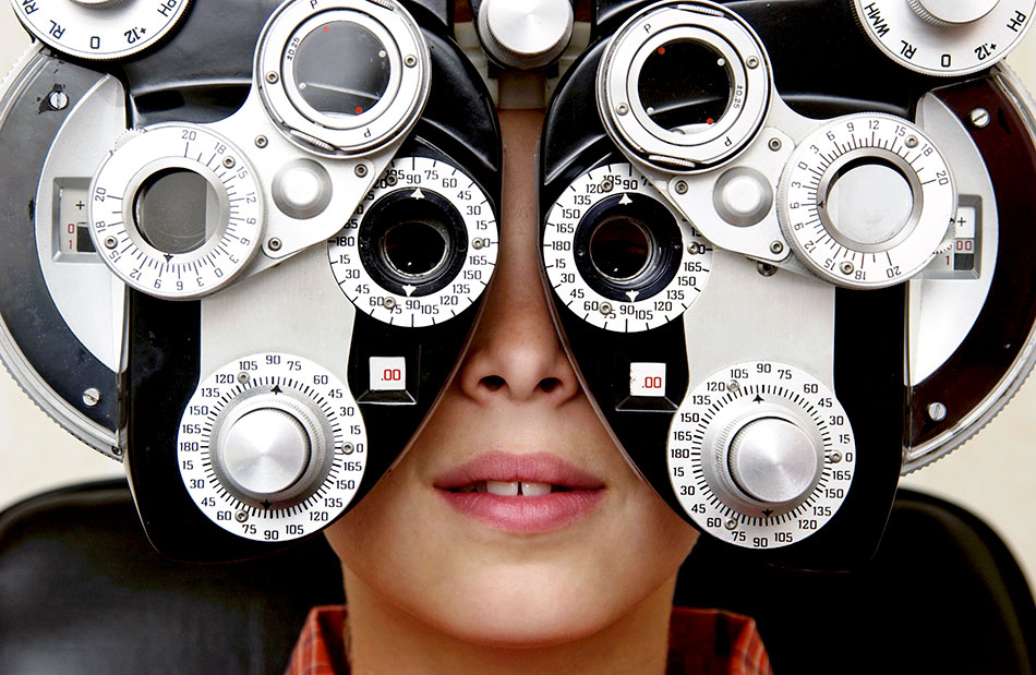 Boy in eye exam for Children's Vision Month