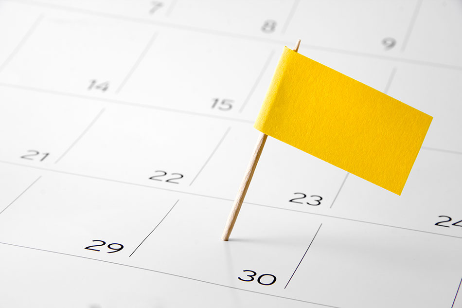 calendar with yellow flag on the 30th