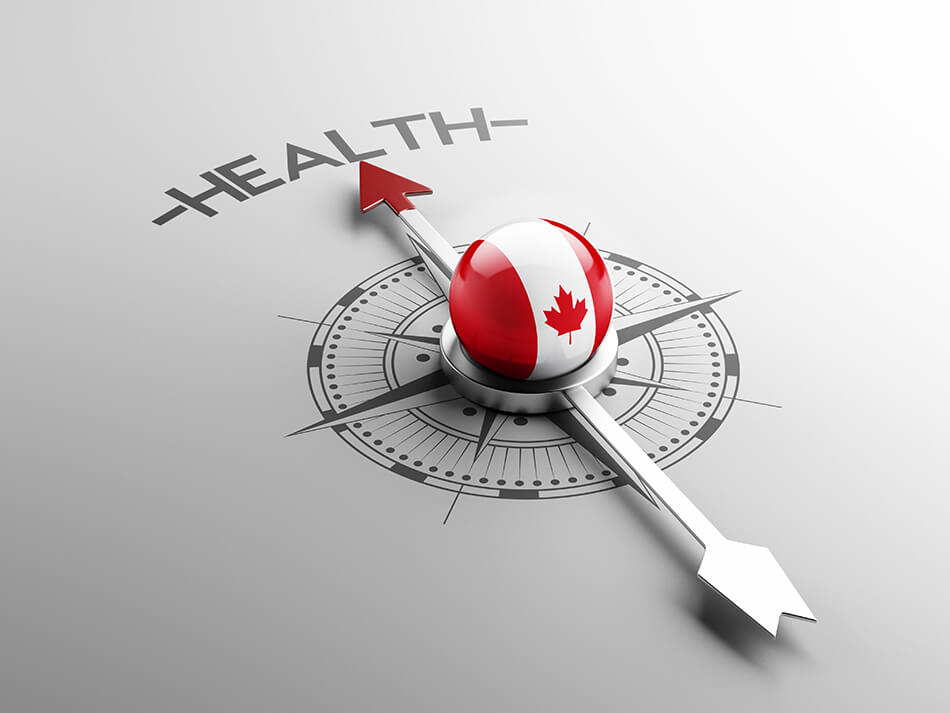 compass with Canadian flag pointing towards the word health