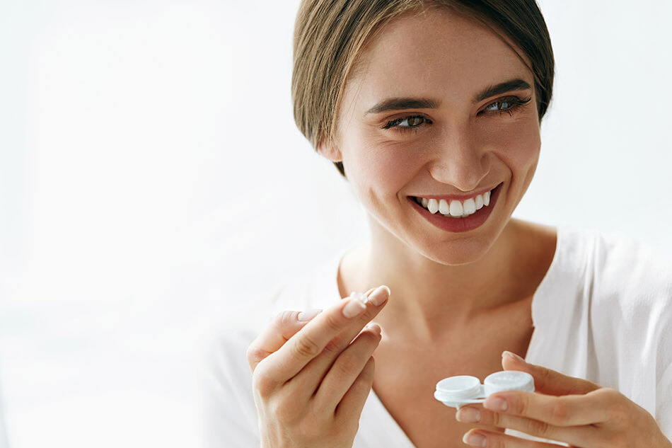 smiling woman practicing proper contact lens care, storage