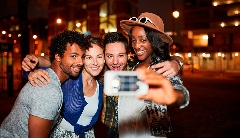 Diverse perfect friends taking Instagrammable travel selfie
