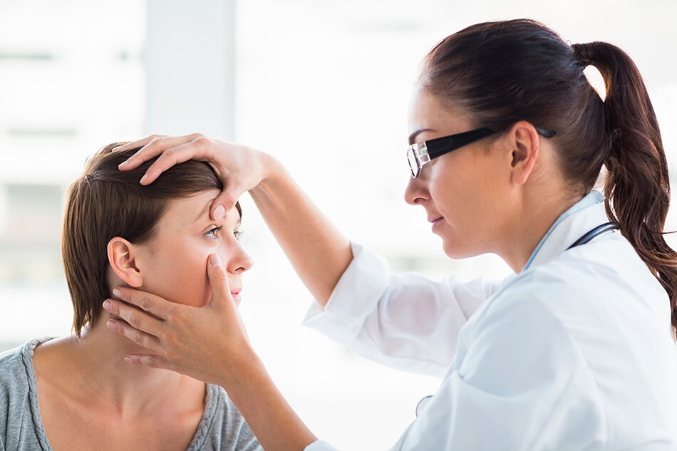 Optometrist checking a patient's eye