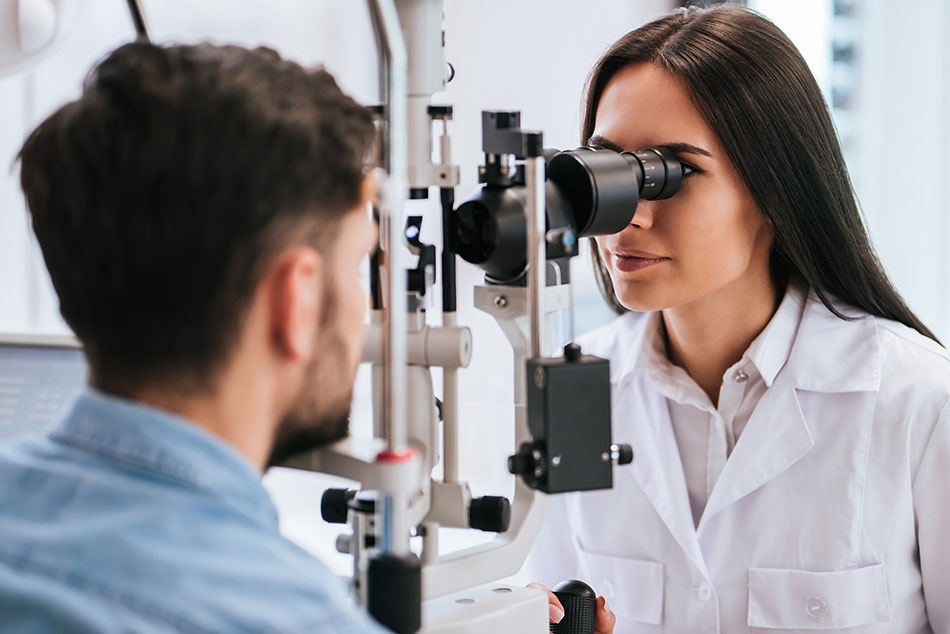 Female eye care professional conducting eye exam