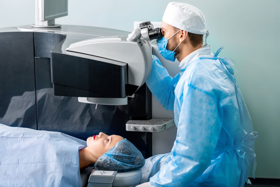 Female patient getting laser eye surgery by male doctor