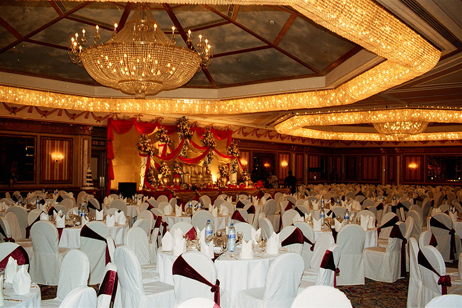 Formal hall with chandelier, white tables and chairs