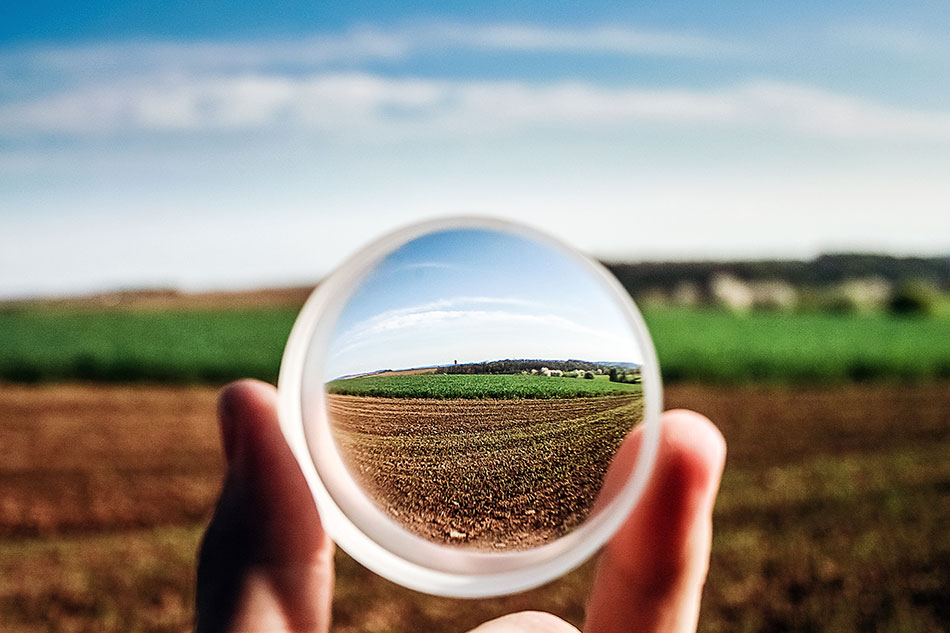 looking through a glass sphere to focus on a field