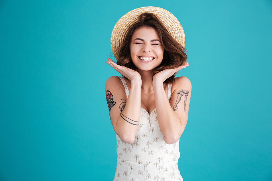 happy woman in straw hat, blue background