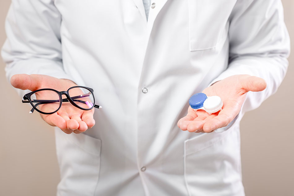 man choosing between contacts vs. glasses