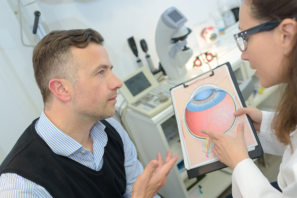 man learning about the eye from doctor