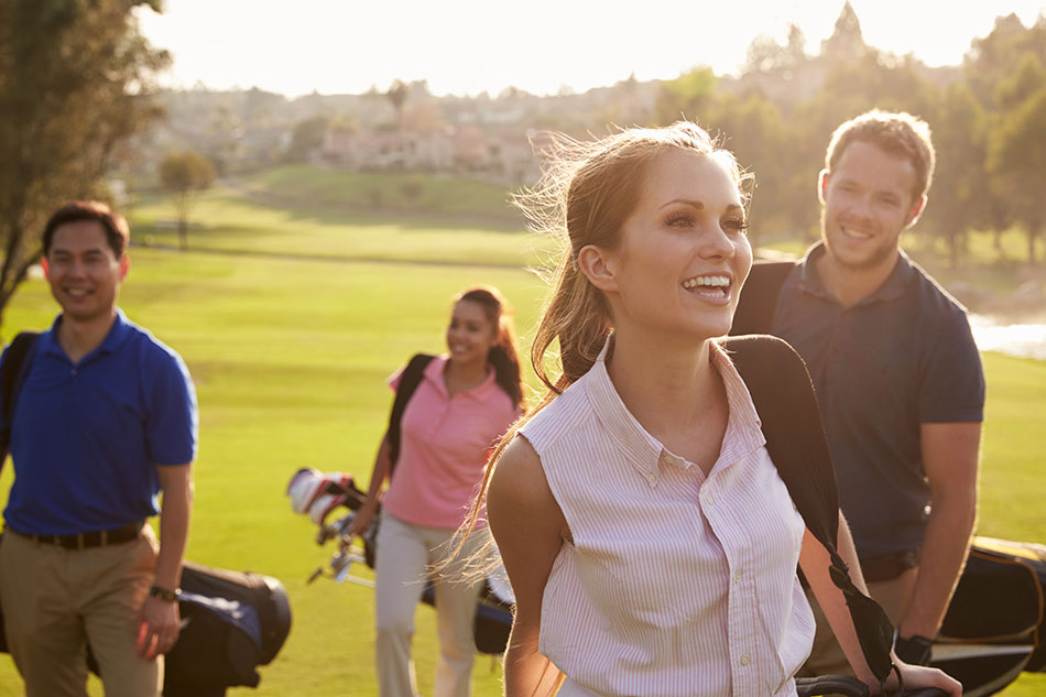 men and women having fun playing golf