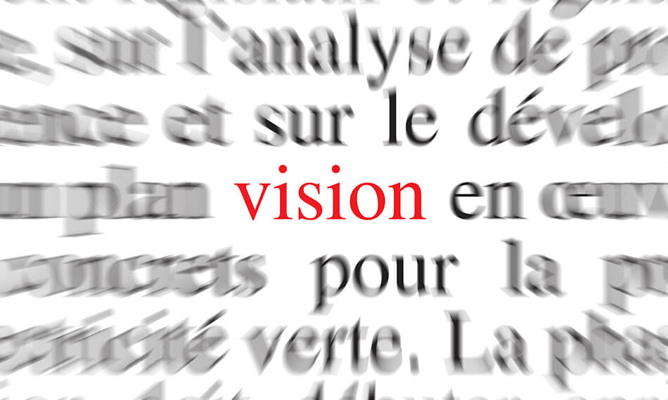 the word vision in red on a blurry background