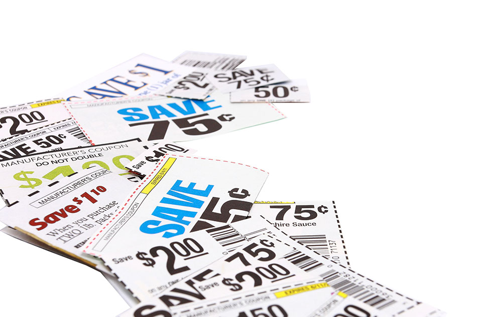 scattered coupons on white background