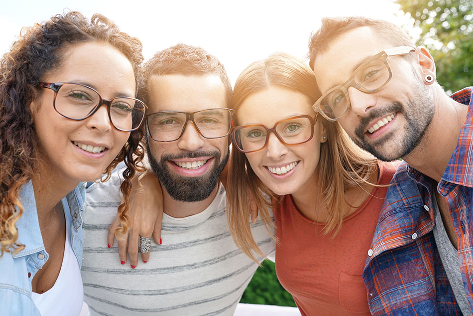 smiling friends wearing eyeglasses