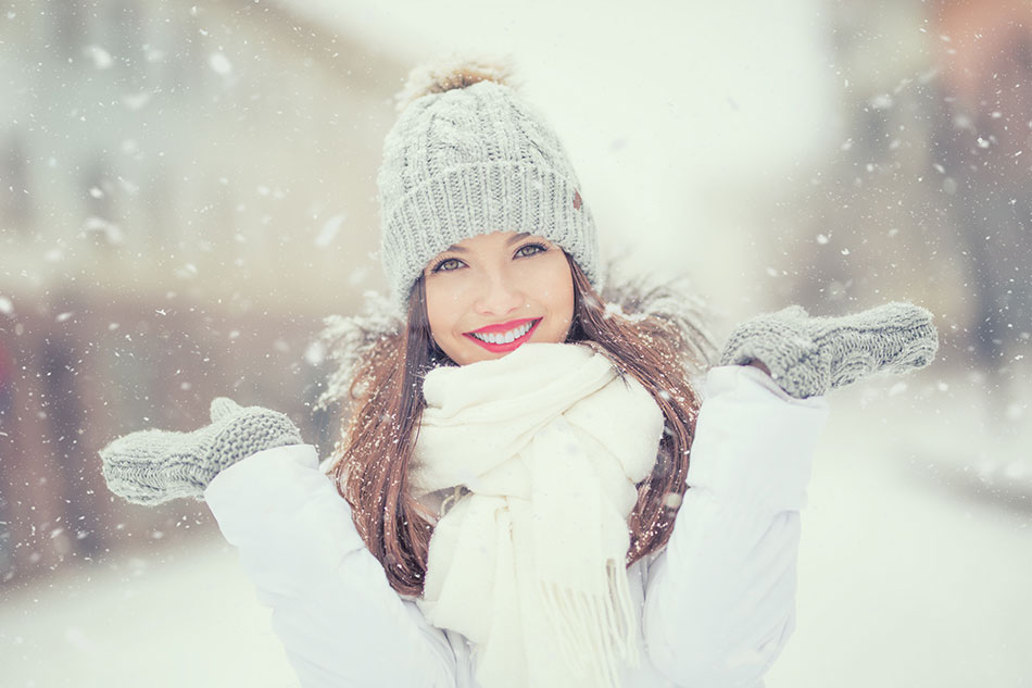 Smiling woman outside in winter