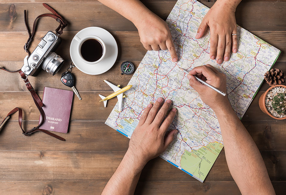 trip planning with map coffee and photo camera