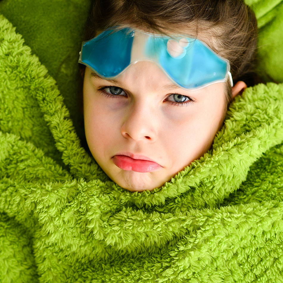 upset child with cool eye compress on forehead