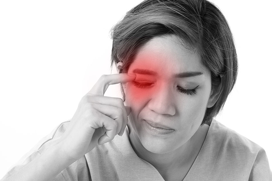 Woman suffering from irritated eyes black and white photo with red overlay