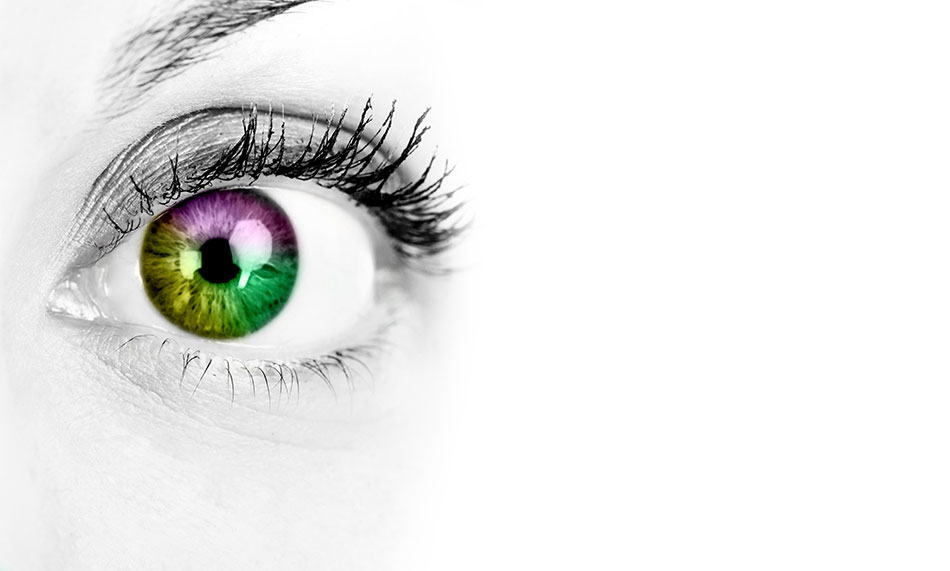 Woman's eye on white background with multi-coloured contact lens