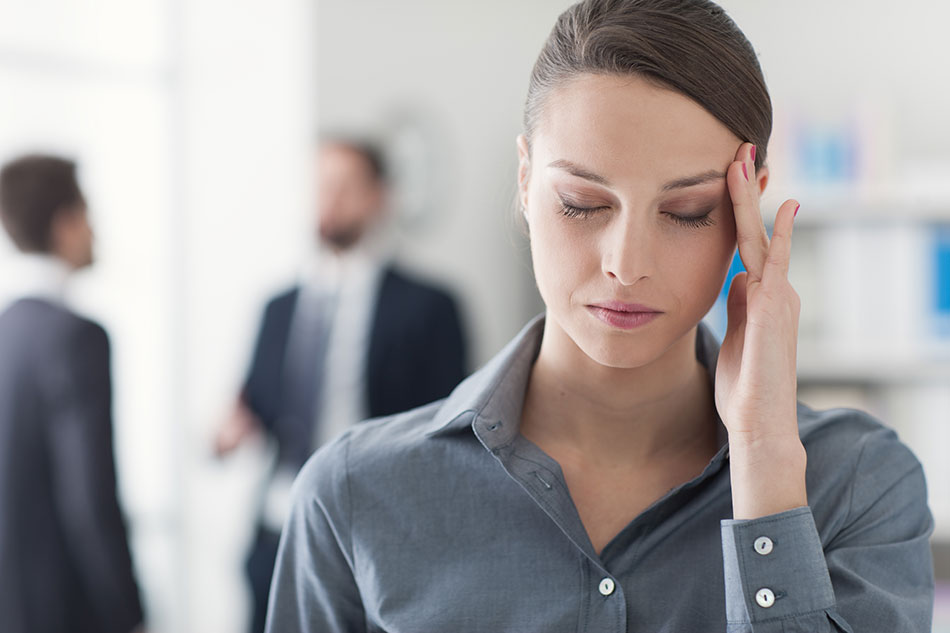 woman with headache at work
