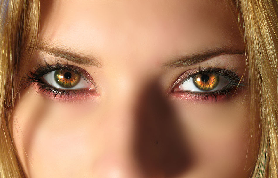 Woman wearing light-brown coloured contacts