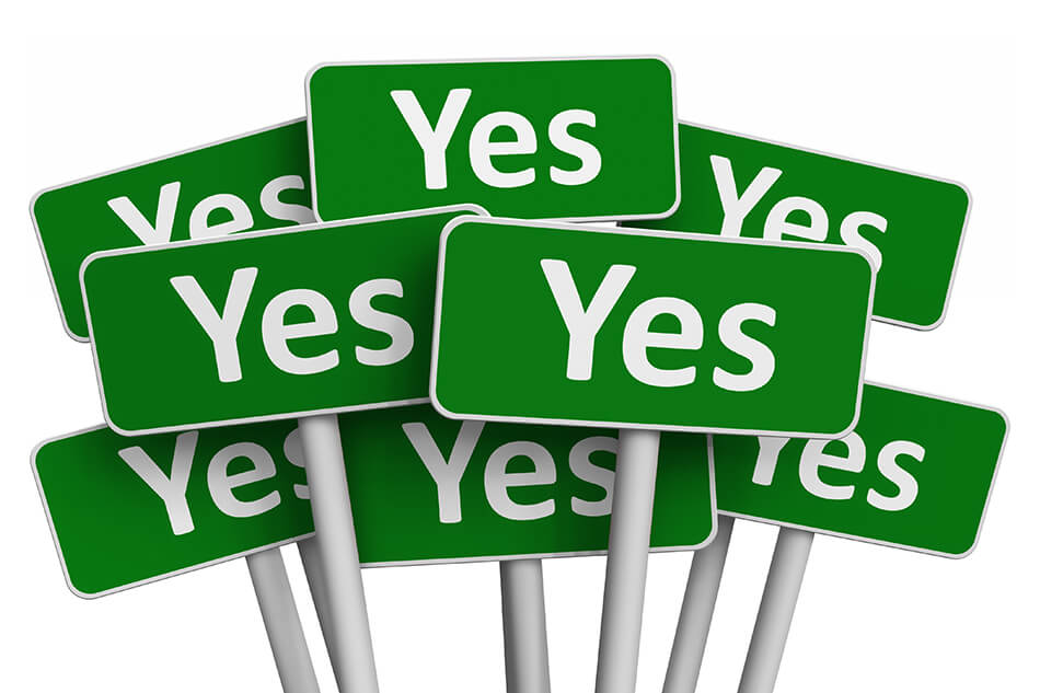 "several green and white ""yes"" signs"